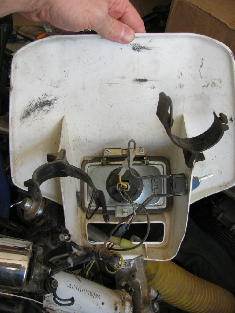 Headlight and shroud from a 1993 Suzuki DR350 dirt model.