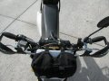 Tusk T-10 Aluminum, CR Mid Bend handlebars mounted on a...