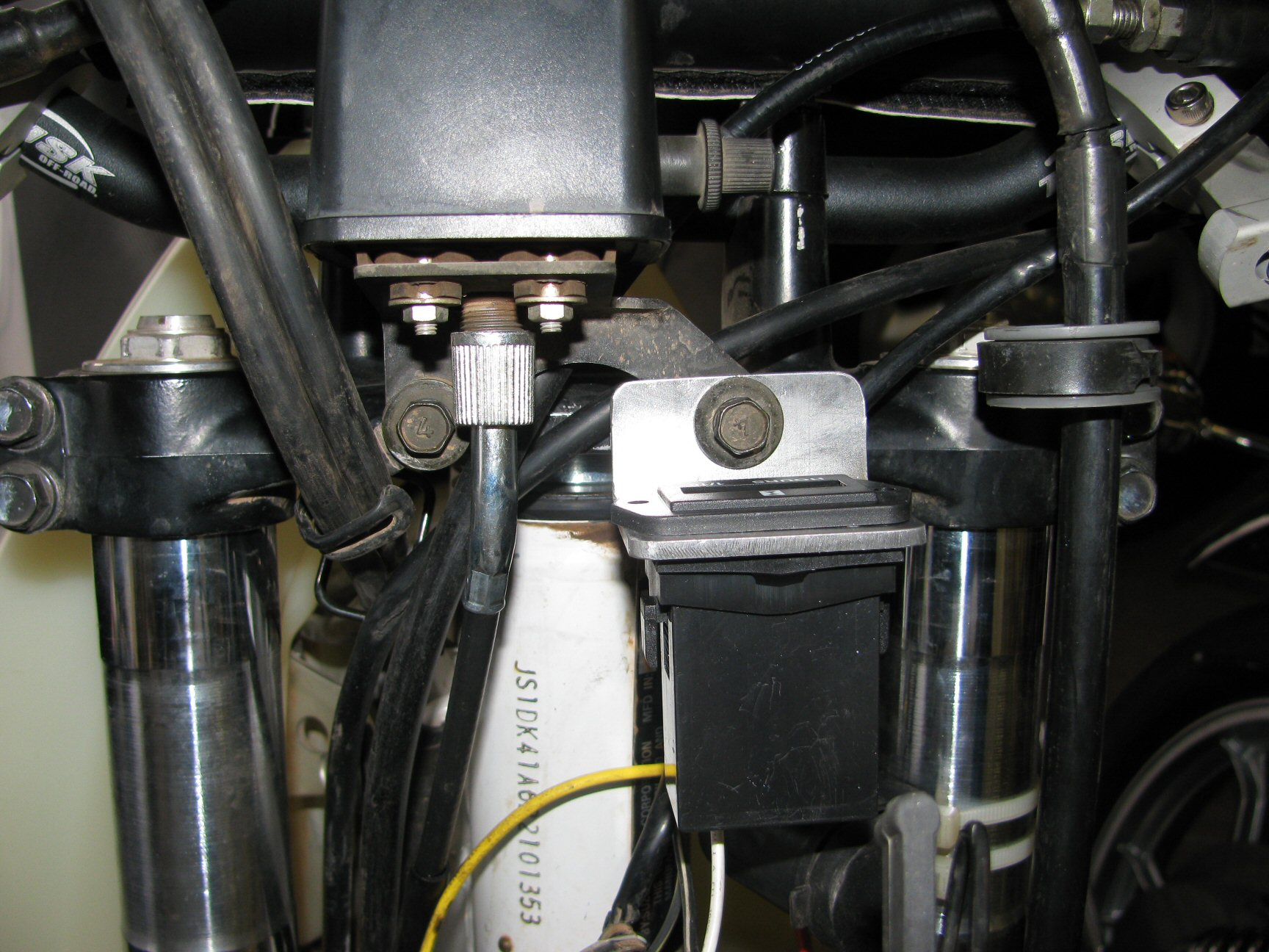 Pro Power Hour Meter installed on a 1993 Suzuki DR350 dirt motorcycle.