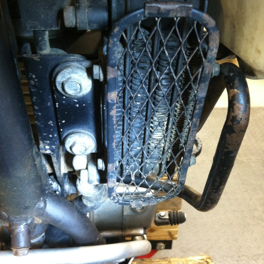 Original oil cooler installed on a Suzuki DR350.