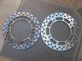Side by side comparison of rear brake discs.