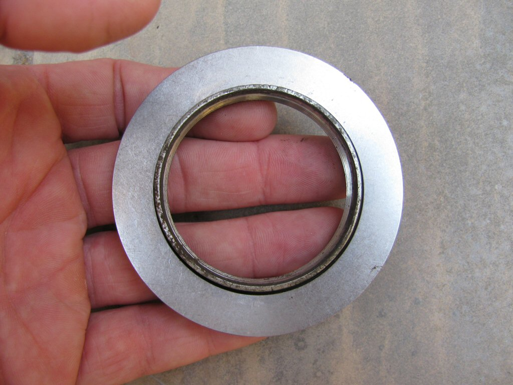 Needle roller thrust bearing used to ease shock preload adjustments on a Suzuki DR350.