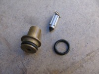 O-ring to seal the float valve seat to the carburetor body (SPN# 13374-35C00).