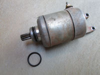 O-ring to seal the starter motor to the left engine case (SPN# 09280-24003).
