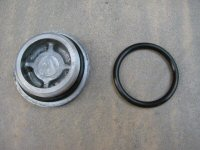 O-ring to seal the large plug to the magneto cover (SPN# 09280-33004).