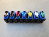 Fuse holders may be ganged together to form a bank of fuses.