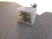 This end plugs into the Moto Guzzi harness.