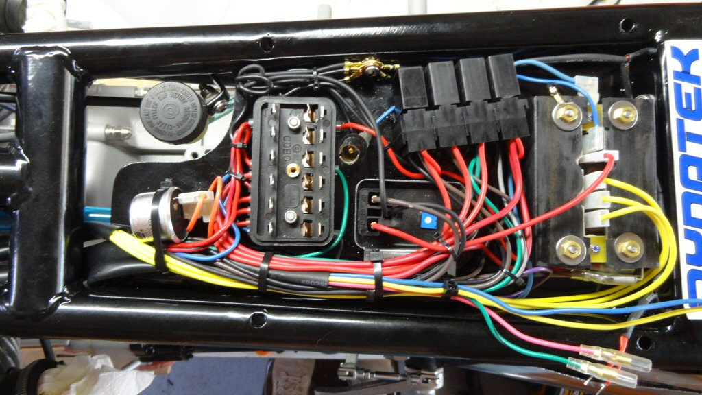 Here is the final tray in place with all of the wiring. It is a lot of wiring, but it all fits and functions perfectly. We also installed four relays: one each for the starter, headlights, coils, and horn.