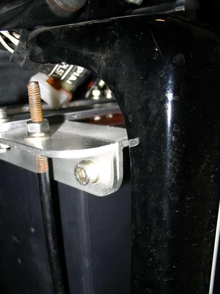 A close-up view of the side cover clearing the battery hold down bracket. Applicable to Moto Guzzi V700, V7 Special, Ambassador, 850 GT, 850 GT California, Eldorado, and 850 California Police motorcycles.