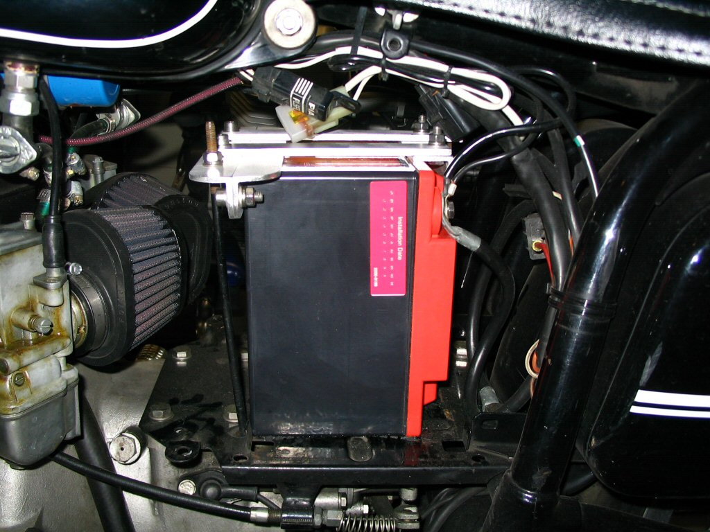 View of the left side of the battery installed with the bracket in place. Applicable to Moto Guzzi V700, V7 Special, Ambassador, 850 GT, 850 GT California, Eldorado, and 850 California Police motorcycles.