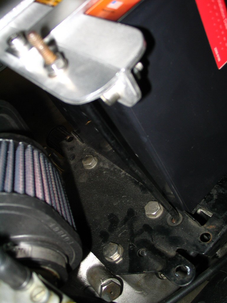 View of the left side L-shaped bolt in the standard position using the standard holes. Applicable to Moto Guzzi V700, V7 Special, Ambassador, 850 GT, 850 GT California, Eldorado, and 850 California Police motorcycles.