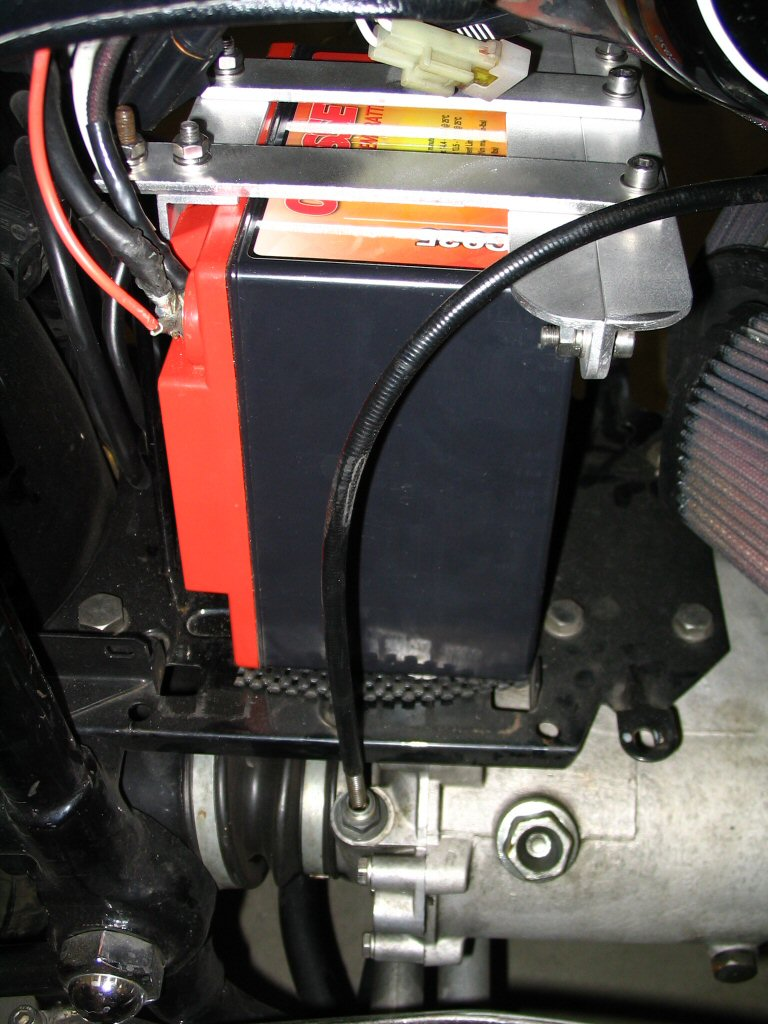 View of the right side of the battery installed with the bracket in place. Applicable to Moto Guzzi V700, V7 Special, Ambassador, 850 GT, 850 GT California, Eldorado, and 850 California Police motorcycles.