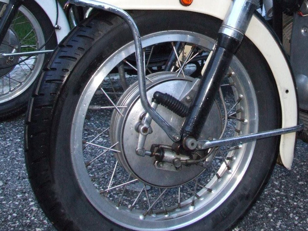 A hydraulic wheel cylinder operates the front front drum brake on a Moto Guzzi.