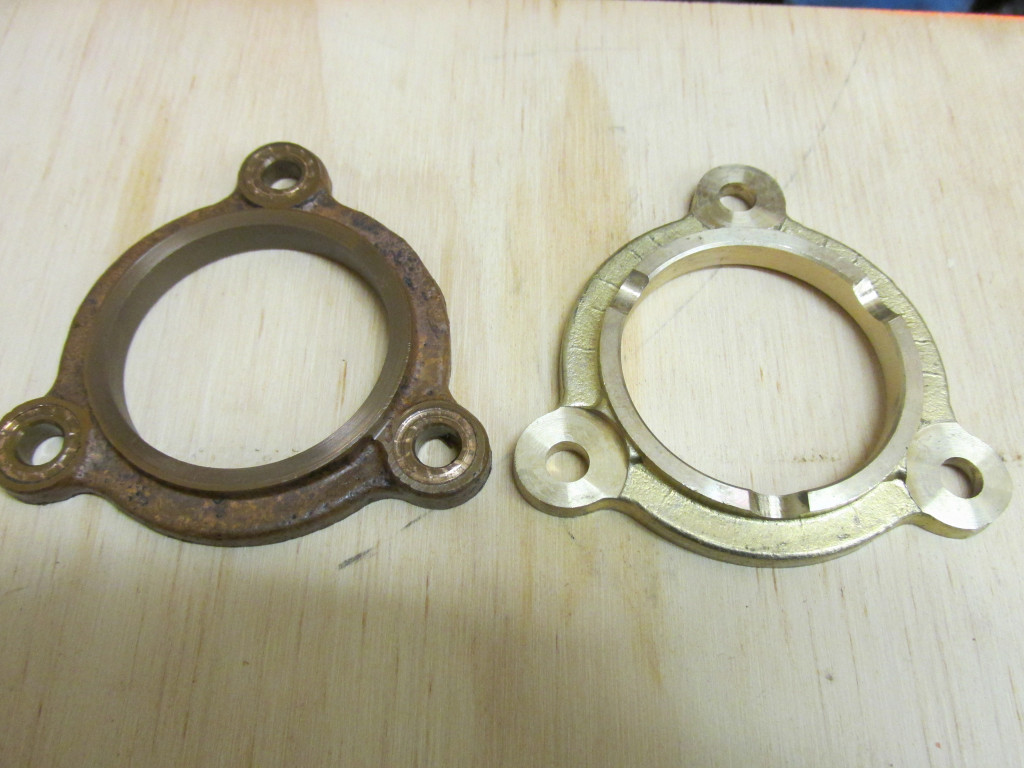 Cam thrust plate. Original on left, new on the right. The original shows considerable wear on the front side.