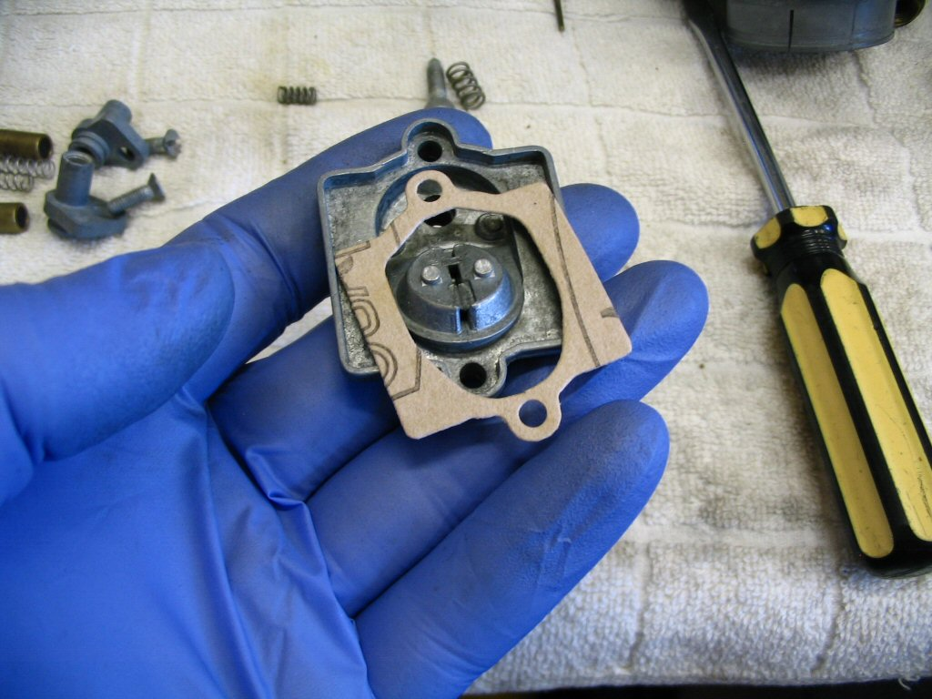 The carburetor top and gasket.