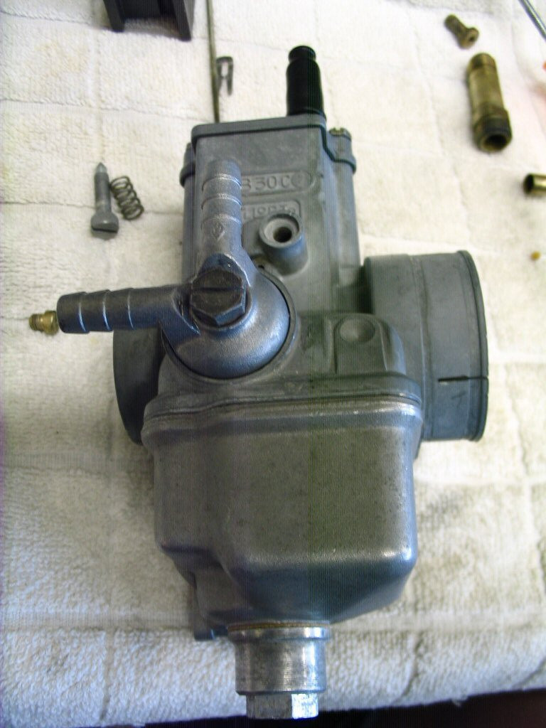 And tighten to secure. You'll want to snug the bolt, but not over tighten. If fuel leaks from this location when you hook up the tank, check a couple things. (1) Did you fit a new plastic filter? If not fit one. (2) Is the banjo fitting bottoming out before it makes sealing contact with the plastic filter? I had one that did this. Drove me crazy until I figured it out. I fit a new banjo and it sealed immediately. Do be careful not to over tighten these bolts. The threads are somewhat easily striped. It is much easier (and cheaper) to replace the plastic filter and banjo than to deal with buggered threads. JUST ANOTHER QUARTER TURN IS NOT YOUR FRIEND!