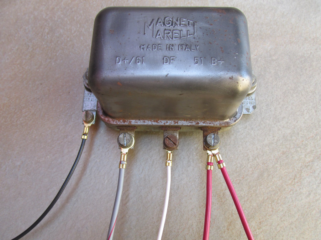 Original Magneti Marelli mechanical voltage regulator.