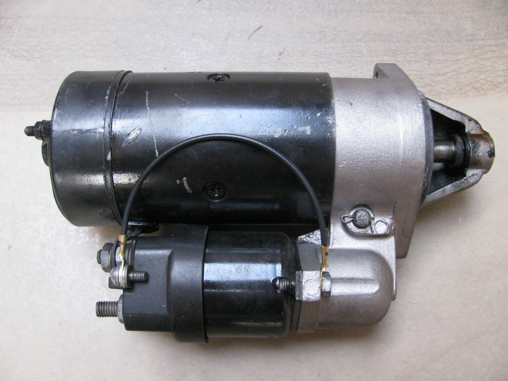The short black wire with two ring terminals grounds the starter solenoid to the starter body.