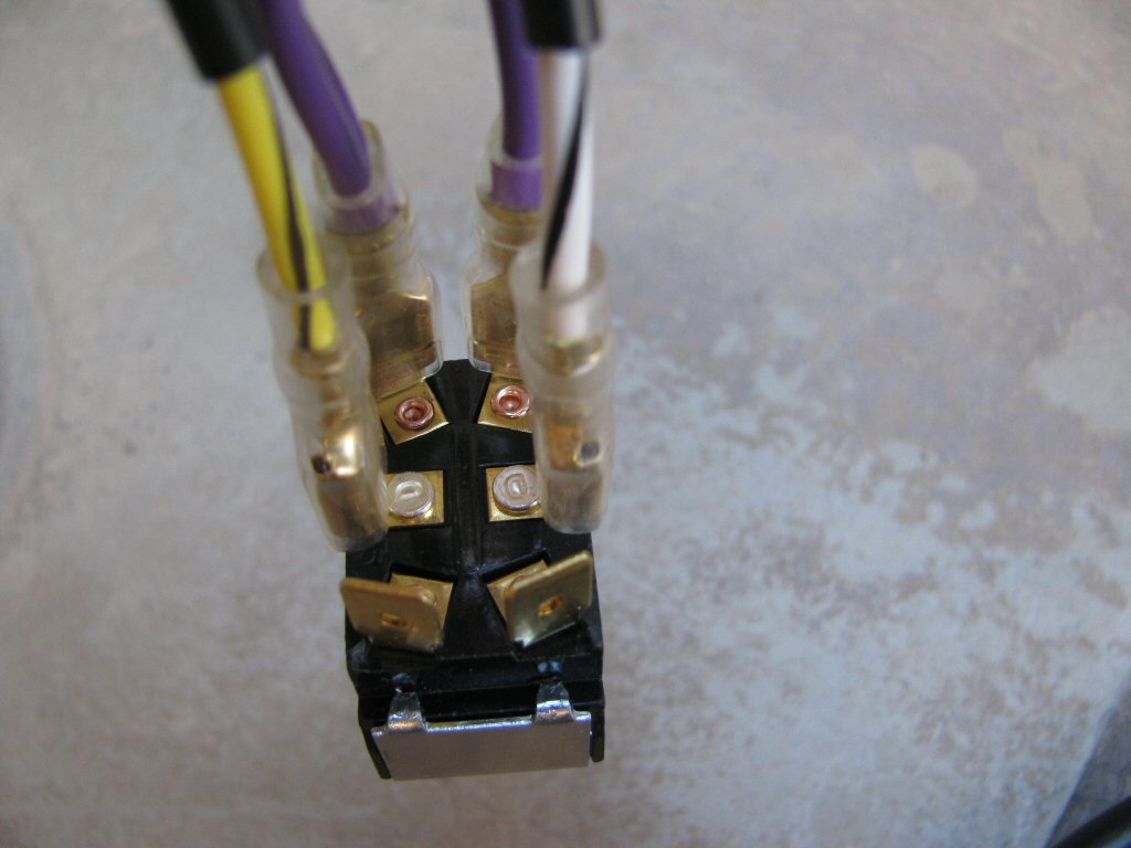 The white/black and yellow/black wires from the toggle switch to 3 connection female spade connectors sub-harness are connected to the middle terminals on the toggle switch.