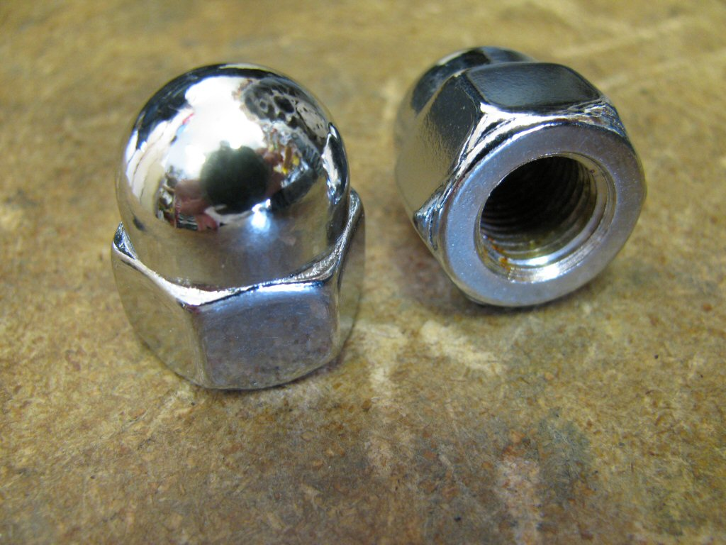 Chrome plated, single piece acorn nuts.