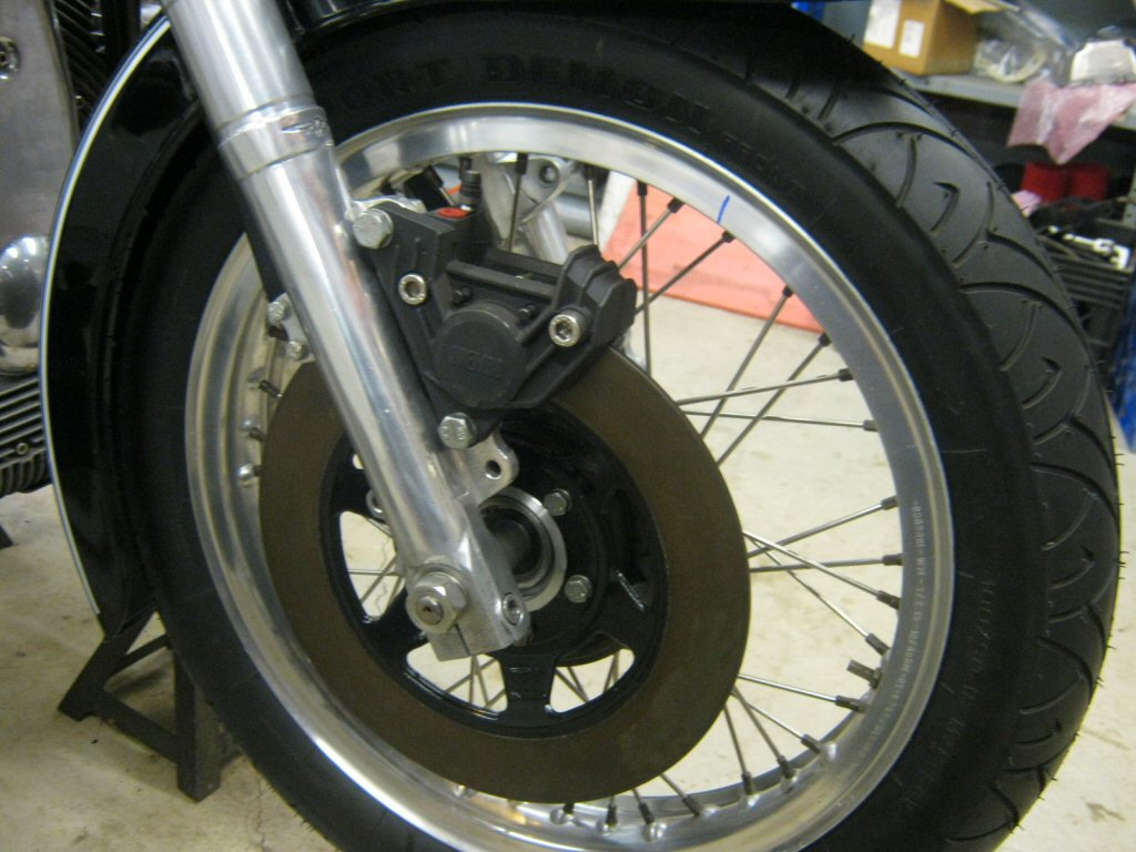 Disc brake spacer as used to fit a disc brake to drum brake Moto Guzzi V700, V7 Special, Ambassador, 850 GT, 850 GT California, Eldorado, and 850 California Police motorcycles.Spacer made by Steve Odell.