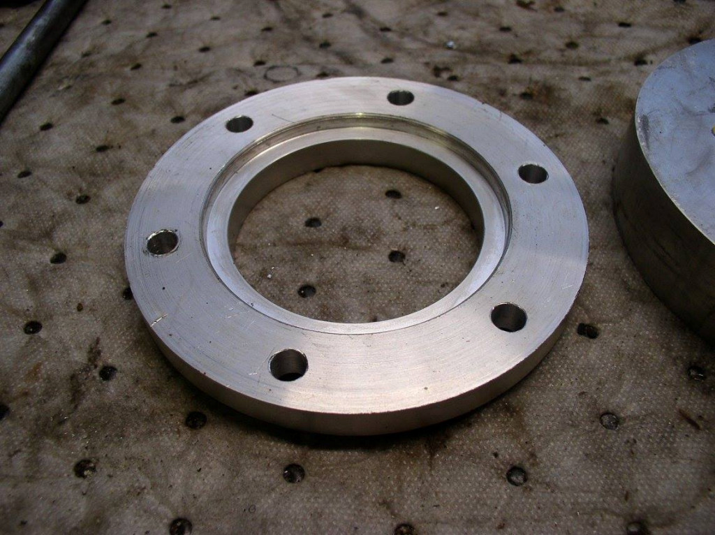Disc brake spacer as used to fit a disc brake to drum brake Moto Guzzi V700, V7 Special, Ambassador, 850 GT, 850 GT California, Eldorado, and 850 California Police motorcycles.Spacer made by Charlie Mullendore of Antietam Classic Cycle.
