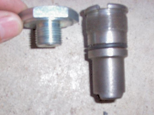 Disc brake fork top nut and tube sleeve for Moto Guzzi 850 GT, 850 GT California, Eldorado, and 850 California Police motorcycles fitted with a disc front brake.