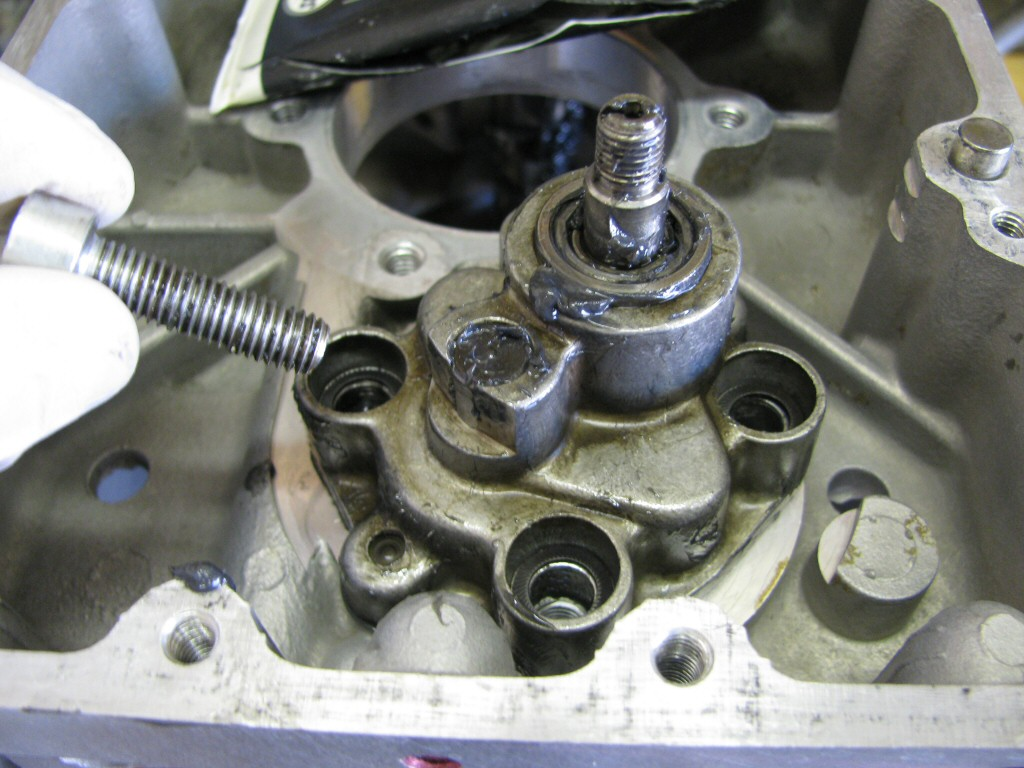The oil pump gets installed with a good coating of assembly lube and new Schnorr washers on the bolts.