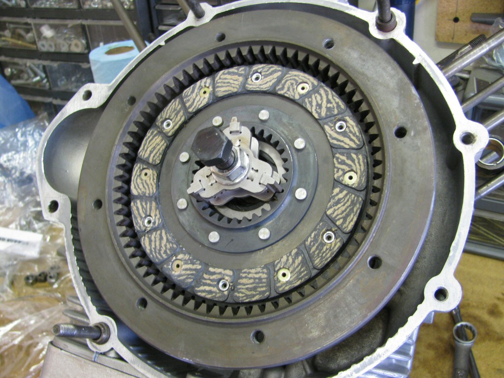 Fit a clutch plate; splines protrude toward the rear.