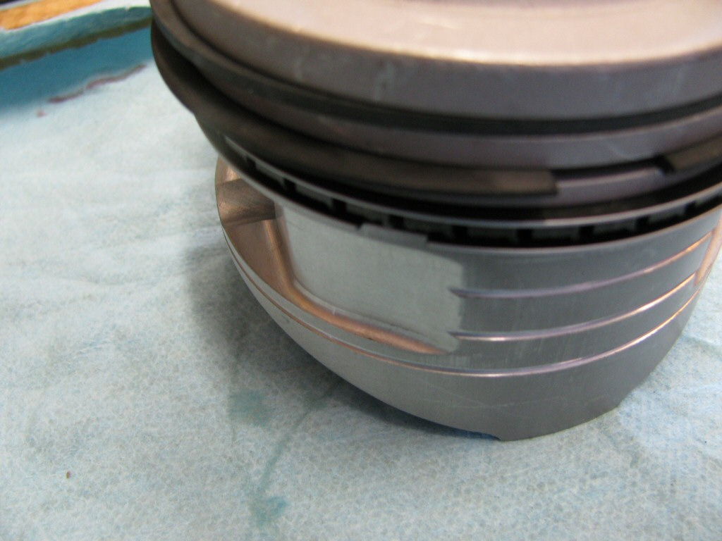 Rings fit to the left piston. This series of photos is intended to show the careful ring gap placement, as per the instructions provided by the piston ring manufacturer (TotalSeal).