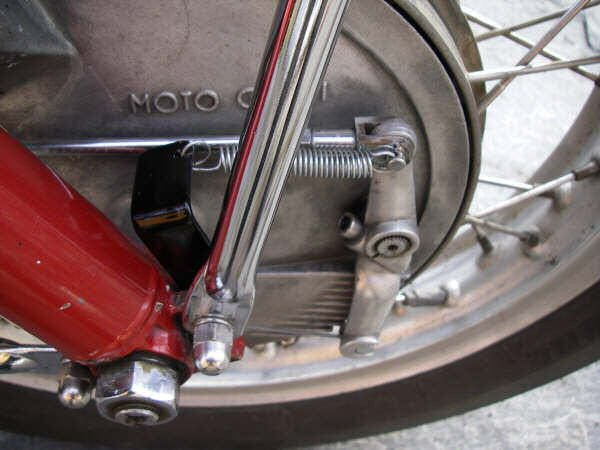 External brake return spring fitted to a 4-leading shoe drum brake as found on some Moto Guzzi 850 GT, 850 GT California, Eldorado, and 850 California Police motorcycles.