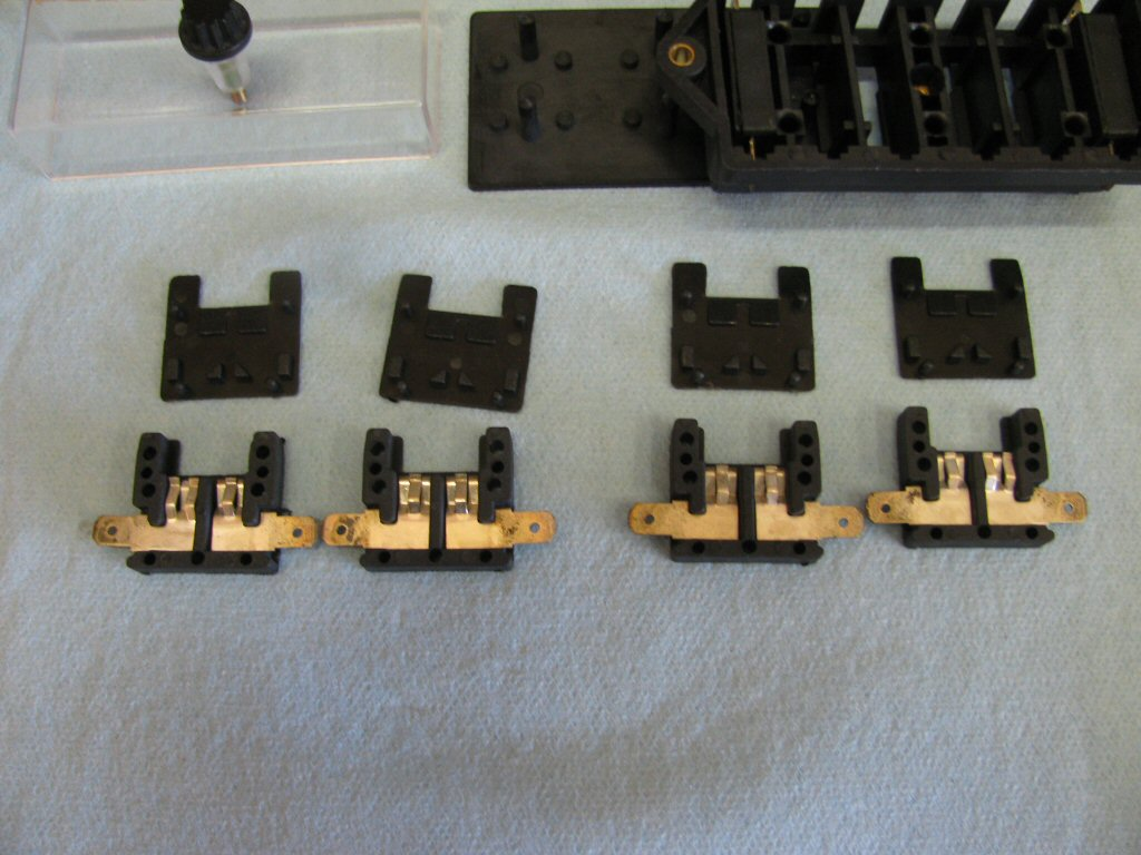 Here are four of the fuse holders disassembled.