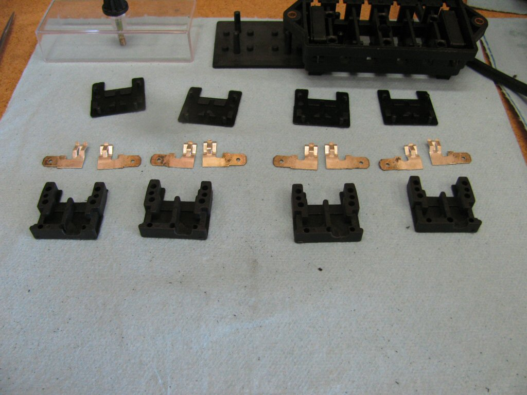 Here are four fuse holders with the material removed for the terminals.