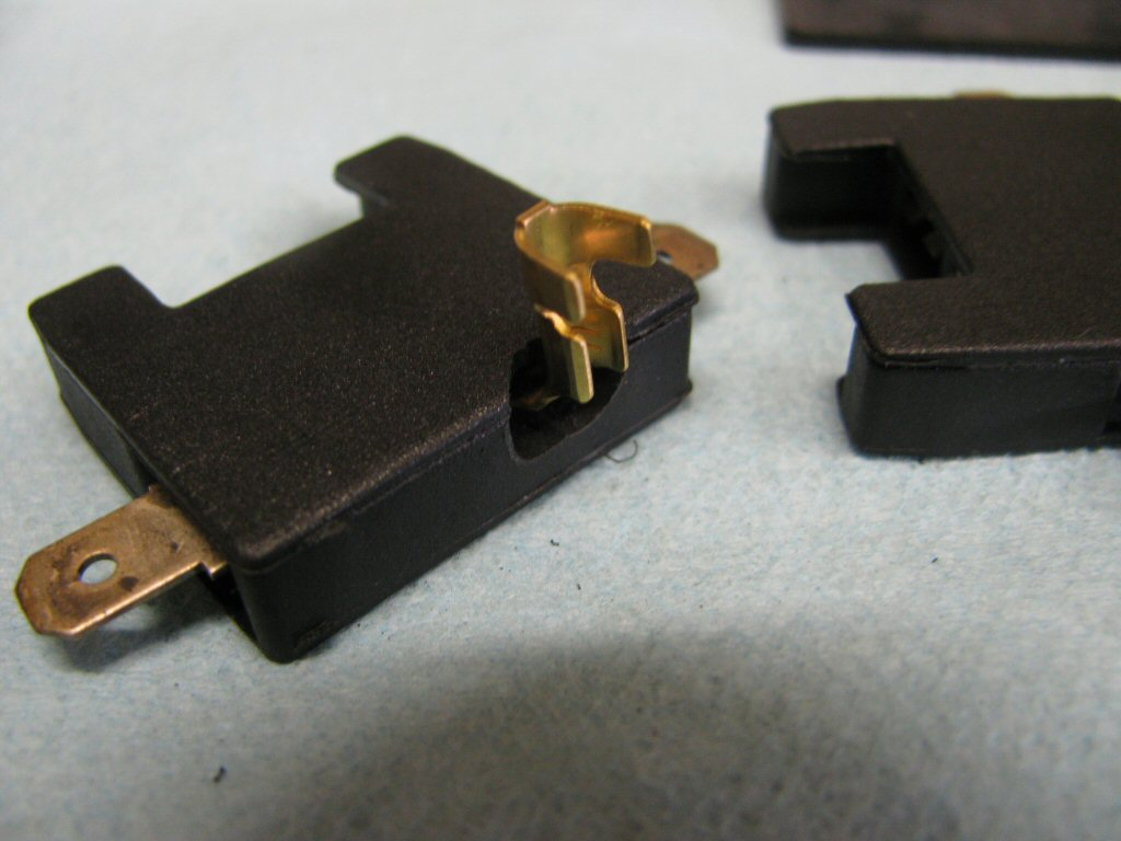 A close up view of the modified fuse holder and cover.