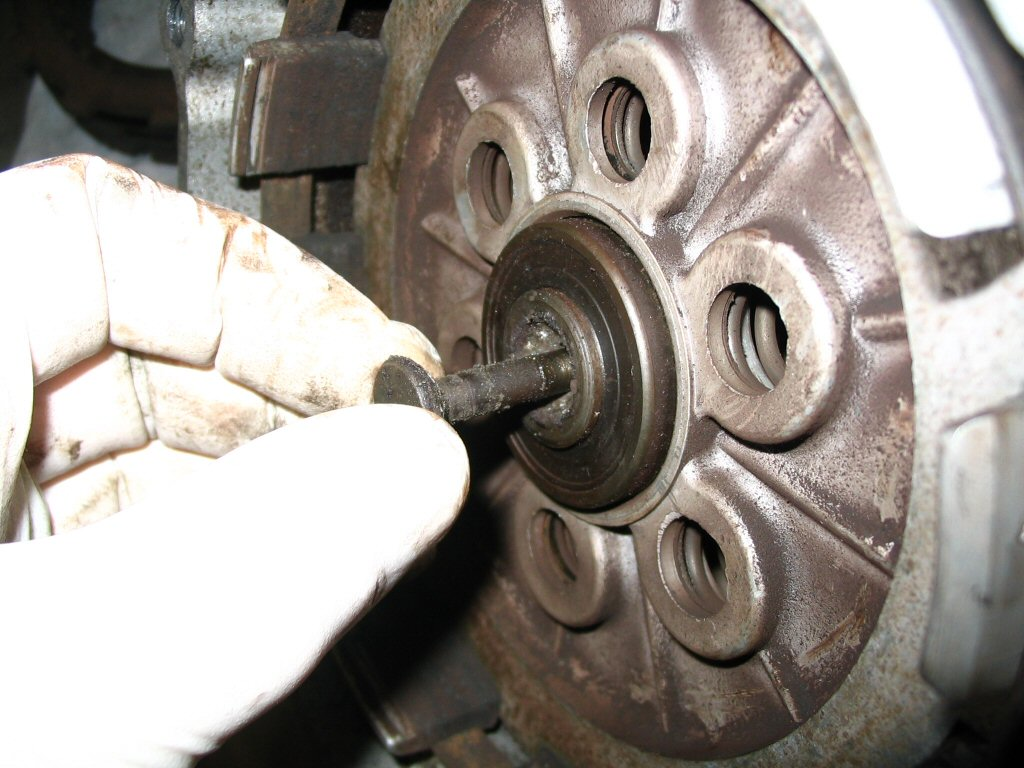 And withdraw the clutch throw out bearing pull rod from the front of the gearbox.