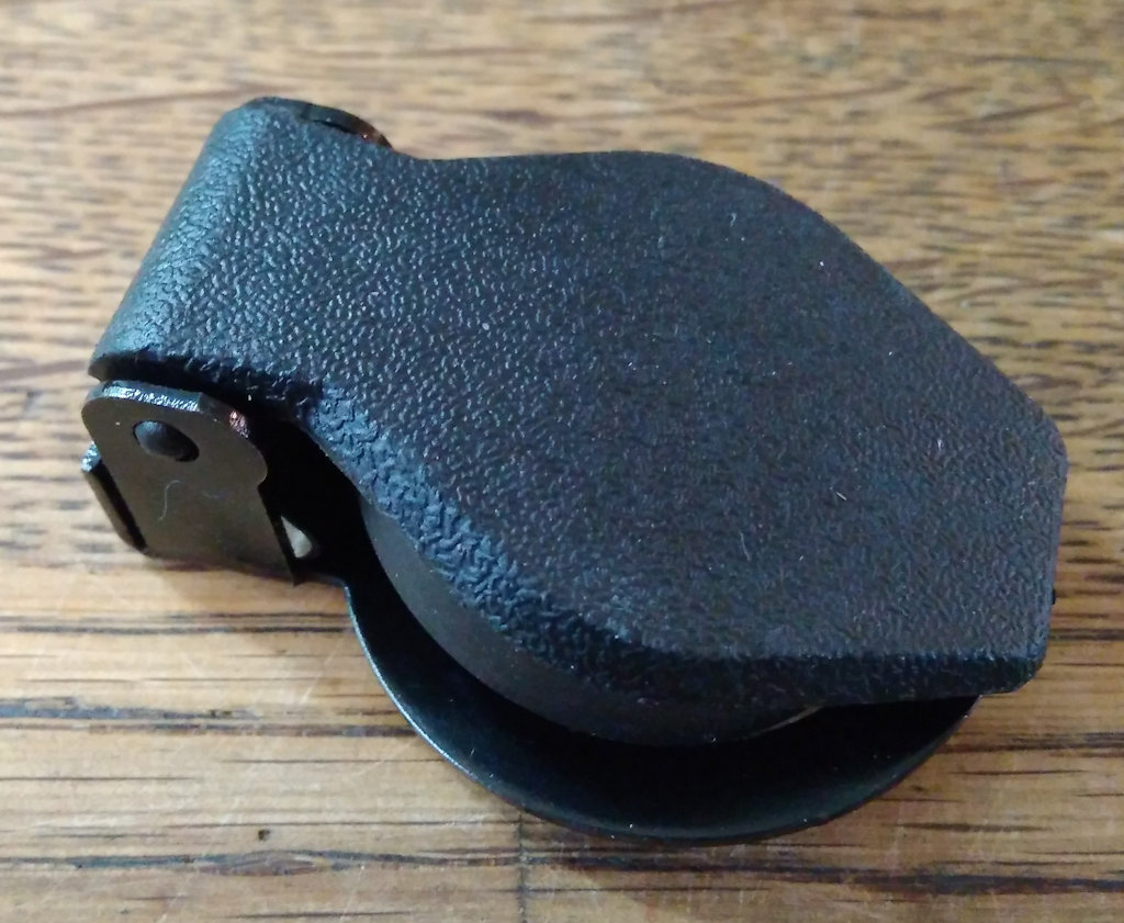 Replacement ignition switch cover with rubber seal.