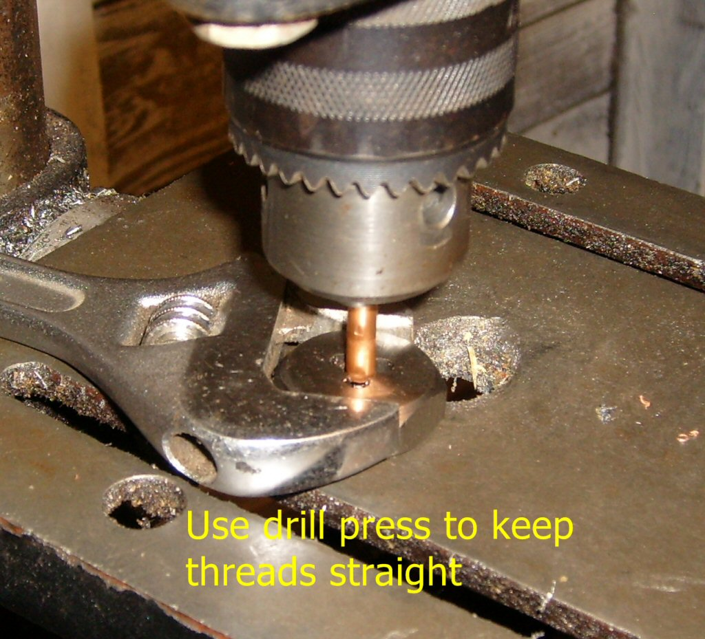 Use drill press to keep threads straight.