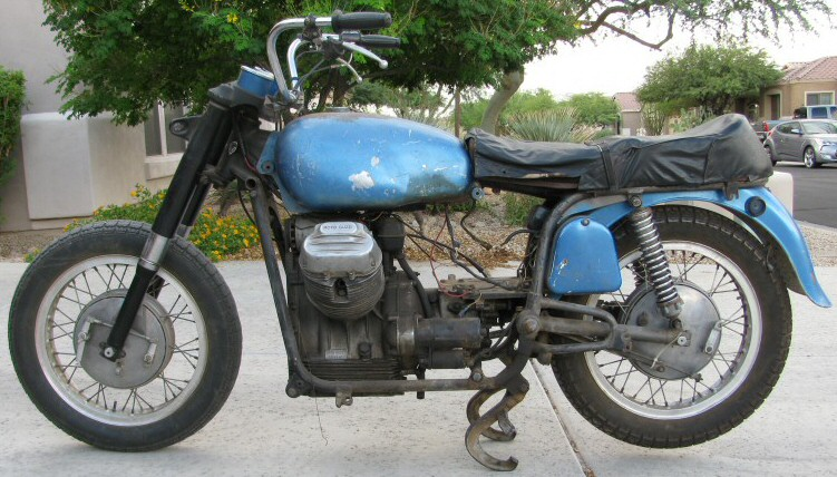 Here is what I am starting with: a 1971 Moto Guzzi Ambassador. Even in its very sad condition I find it attractive.
