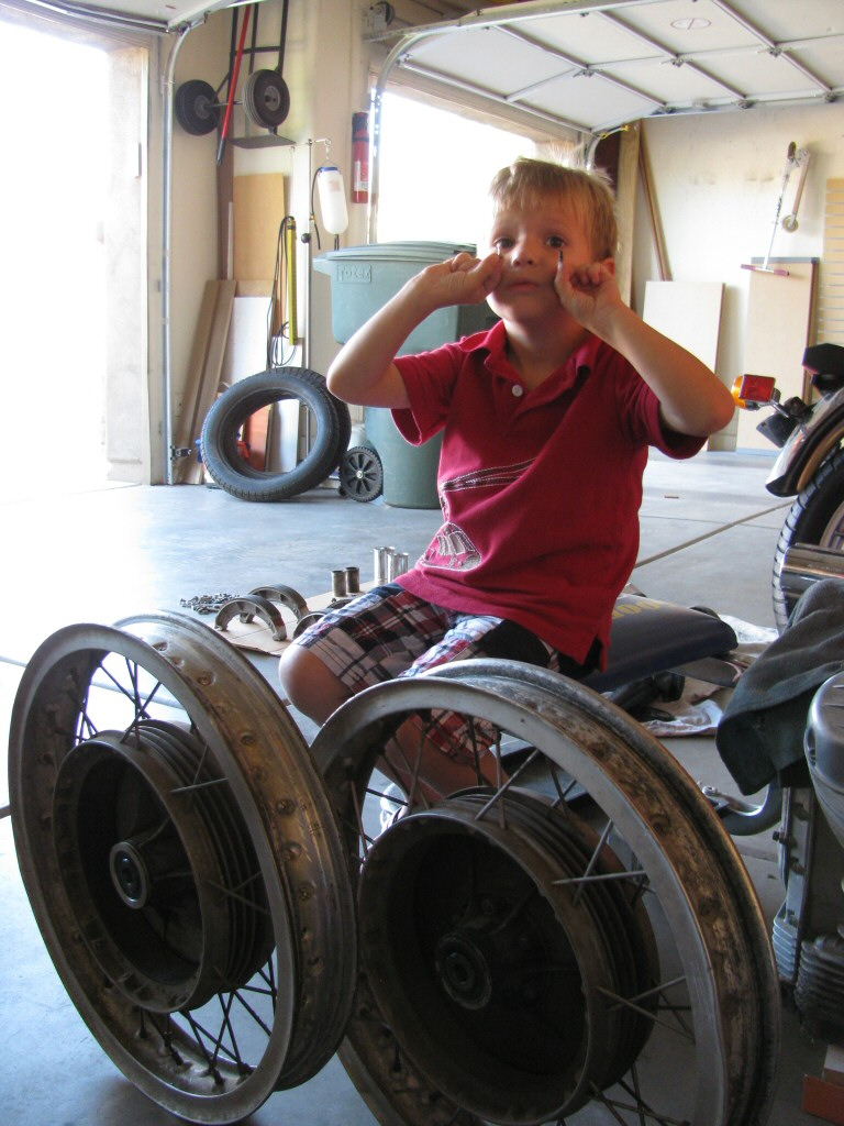 Abraham helped remove the tires. He was intrigued with the valve cores and noted that the two were not identical.
