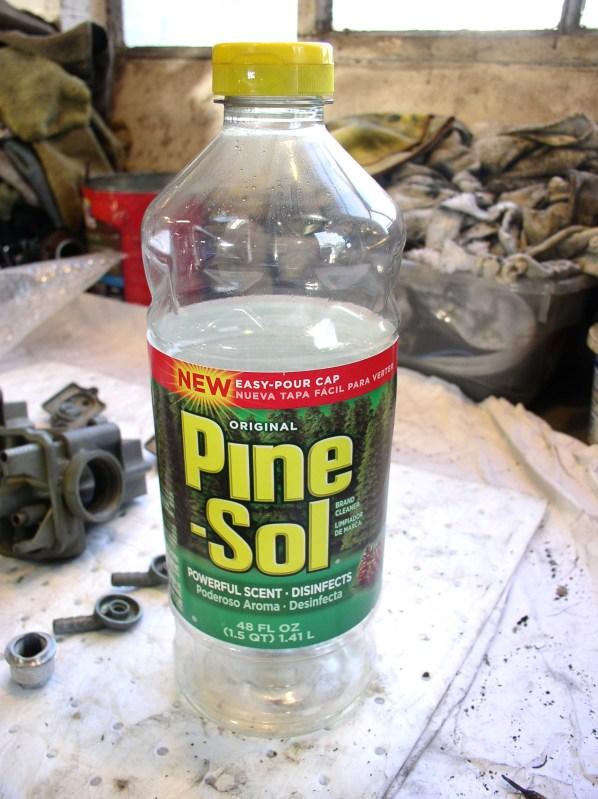 One of the two bottles of Pine-Sol used to clean Moto Guzzi carburetors.