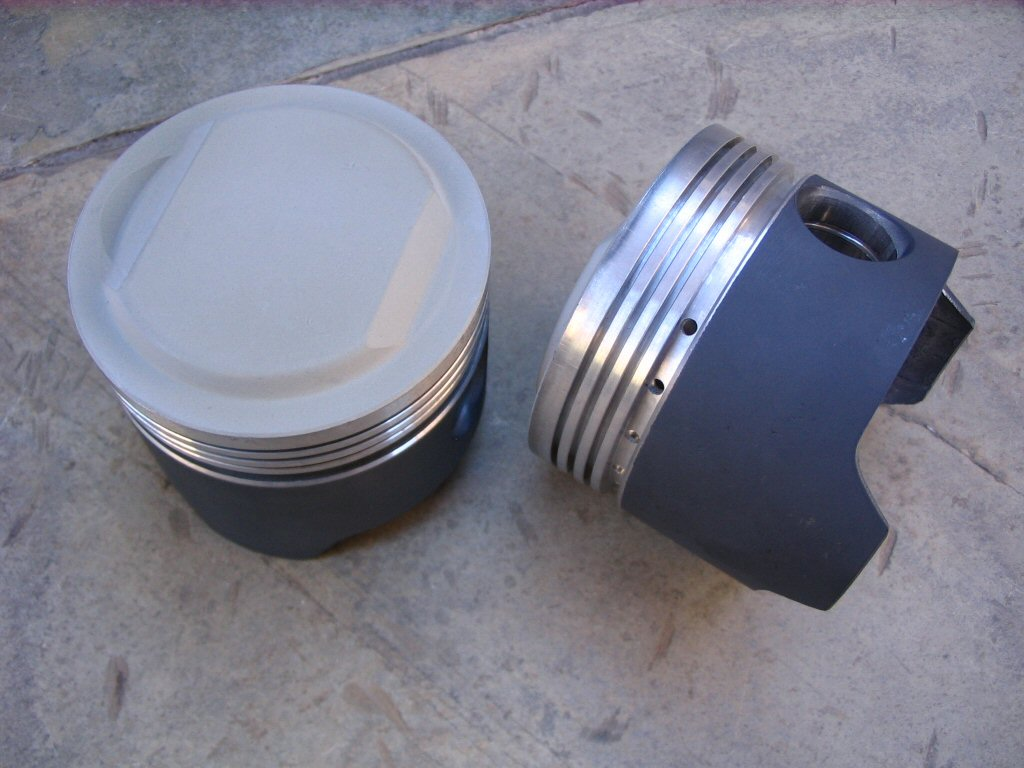 Swain Tech coated pistons, TBC on Dome and PC-9 on Skirt.