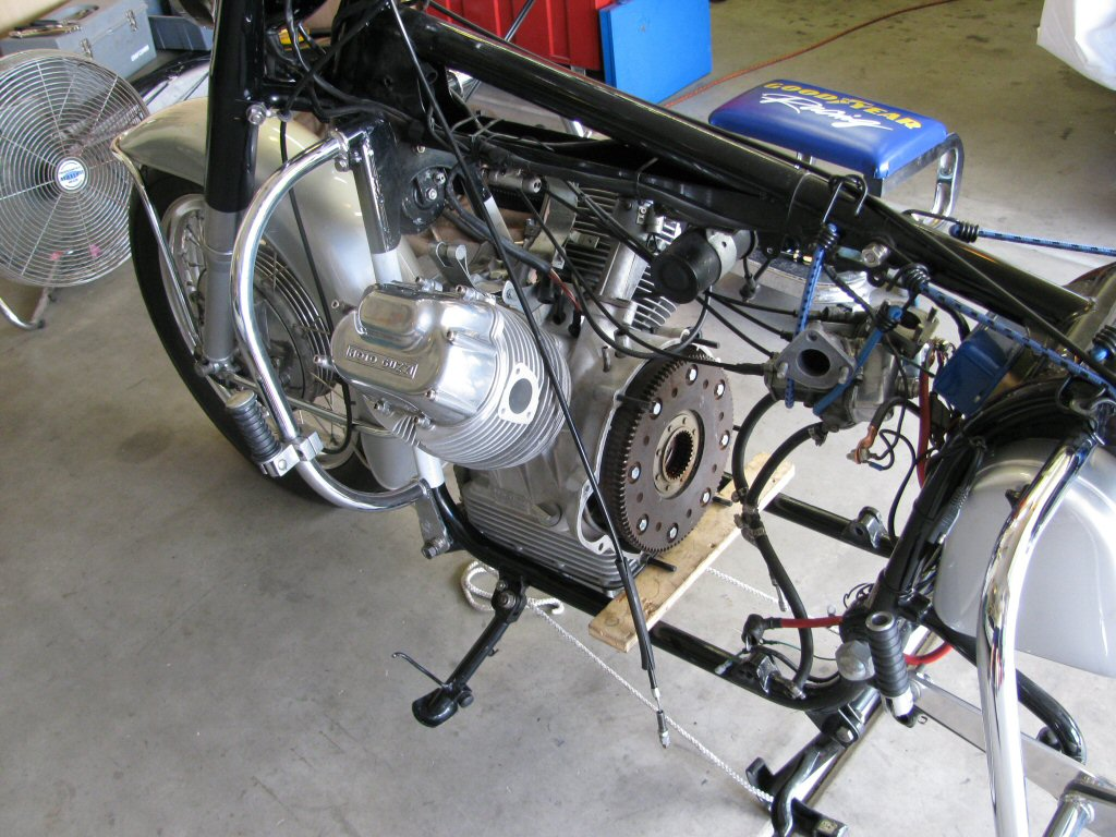 Rear of engine supported with a board.