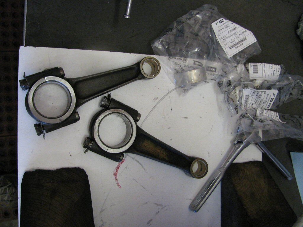 Connecting rods and plastic bags containing the new shells.