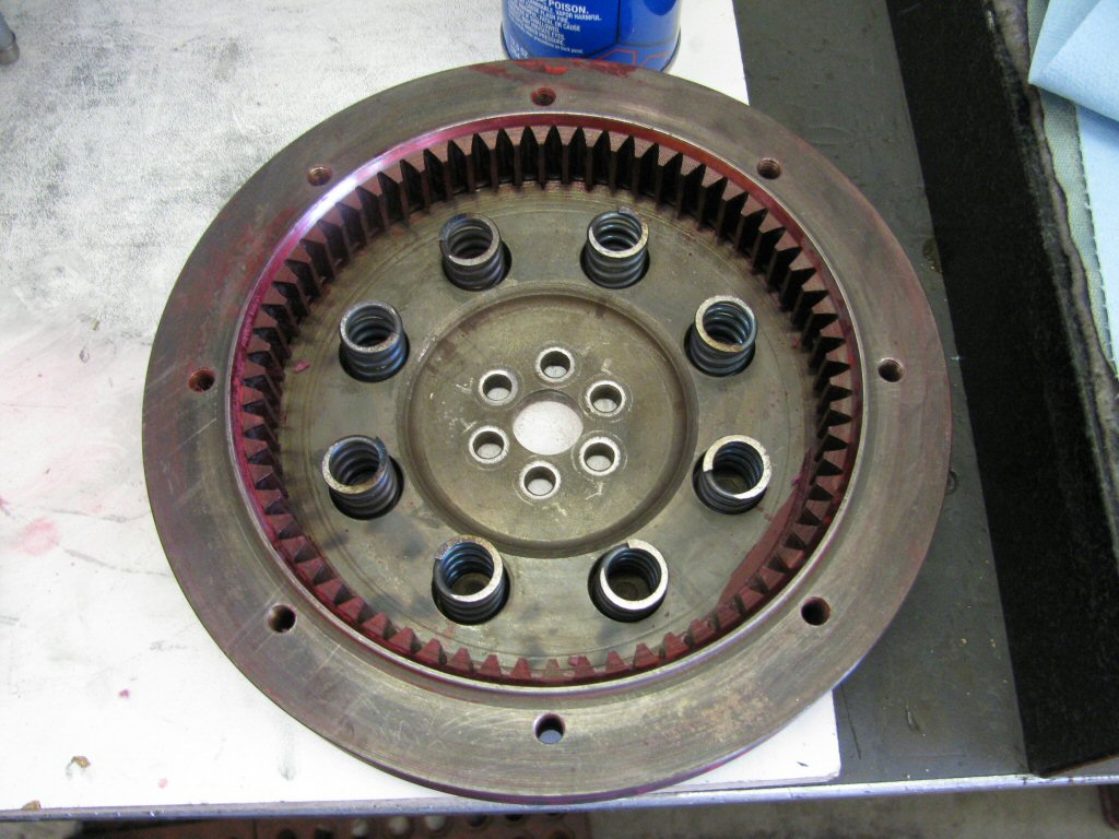 Flywheel with new springs. Red color is from layout dye that was used when diagnosing engine/transmission misalignment.