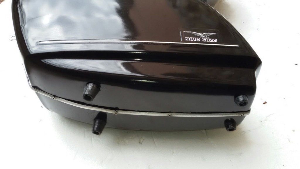 Original Moto Guzzi saddlebags that have had the handles removed from the lid (smaller).