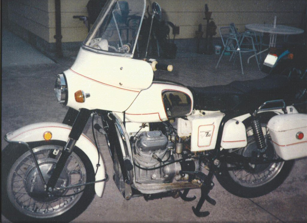 George Vignovich's A-series Moto Guzzi Ambassador with metal saddlebags.