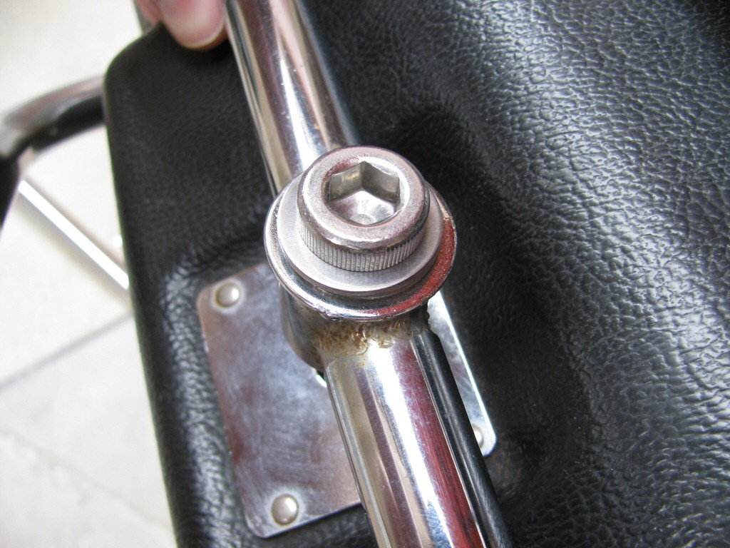Bolts to secure Samsonite motorcycle saddlebags to the rack.