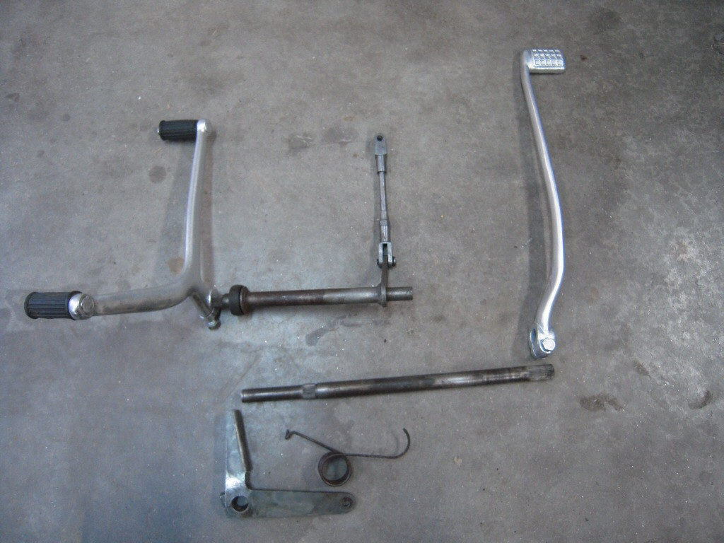 Factory kit for converting a V700 to have left side shift/right side brake.