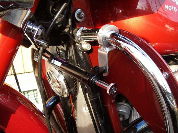 Joe Jump's steering damper kit fit to Frank Granli's motorcycle with leg shields.
