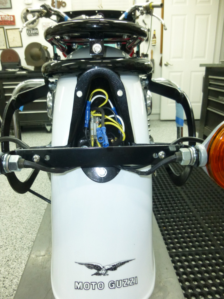 Tail light bracket cover
